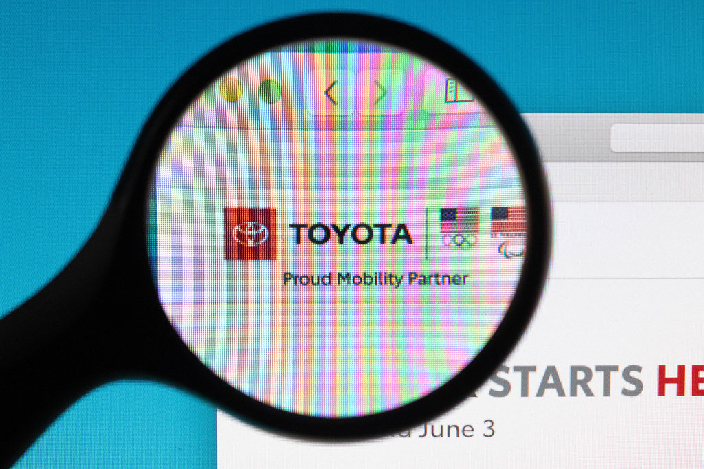 Toyota logo under magnifying glass