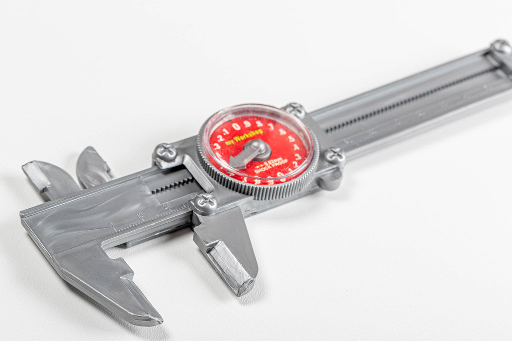 Plastic caliper-childrens toy on a white background