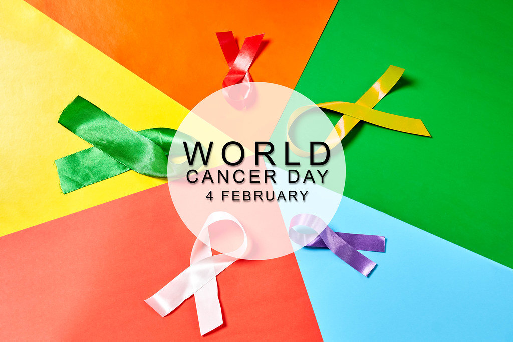 World cancer day and colored ribbons as symbols of different cancer disease types