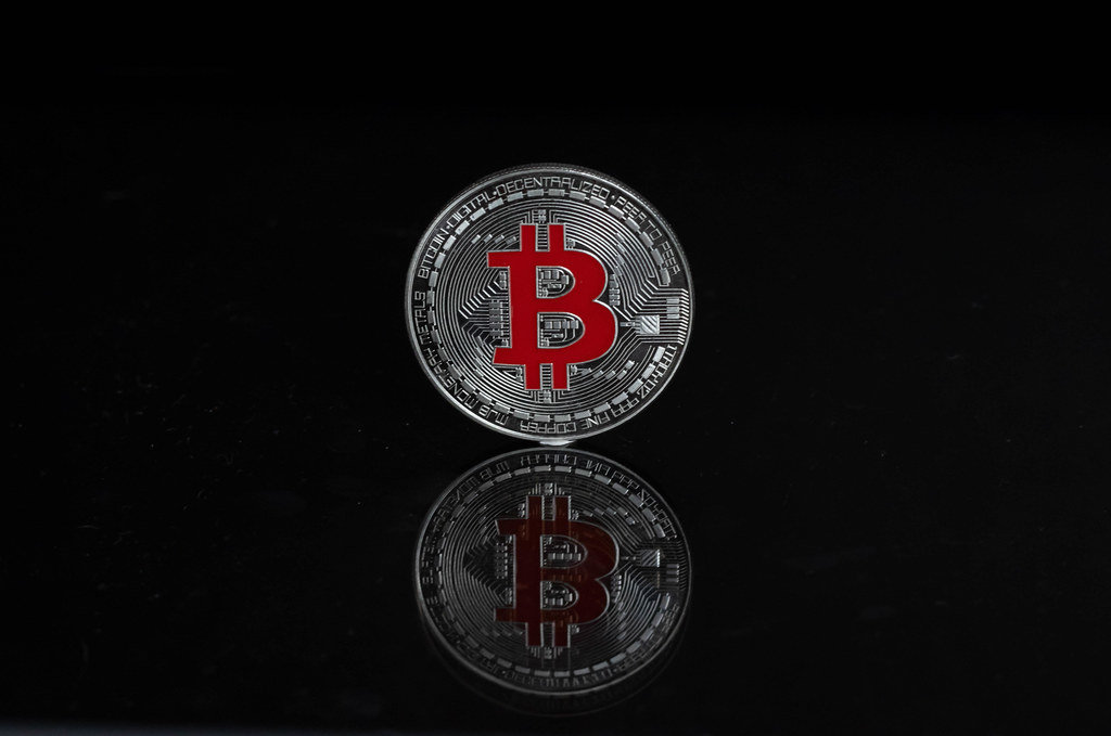 Silver Bitcoin on a black background