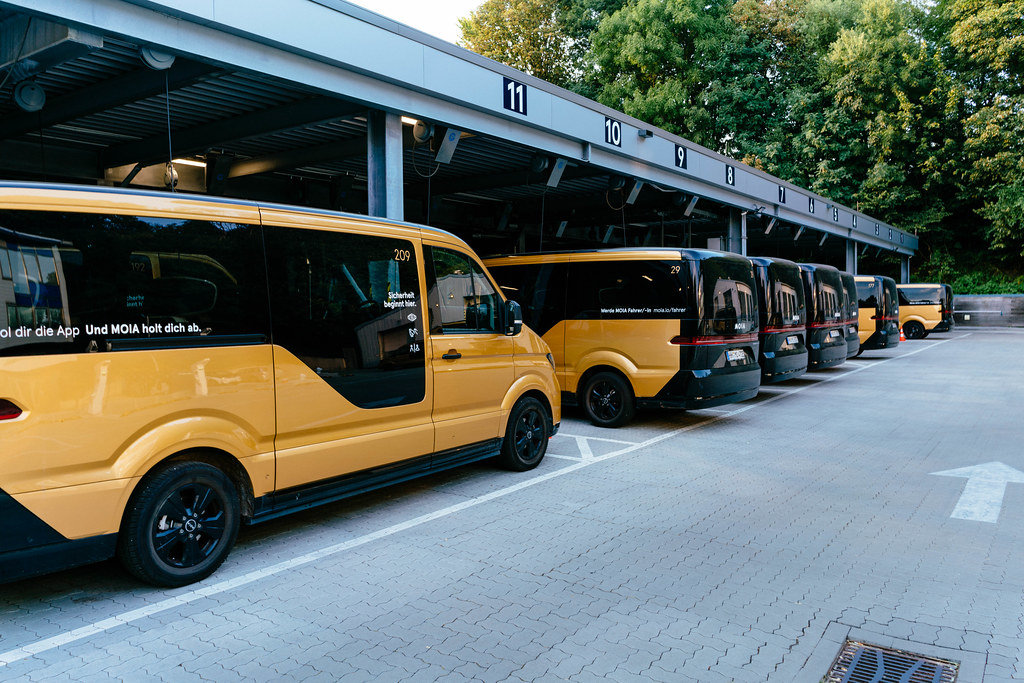Many electric ride-hailing buses parked at their base station