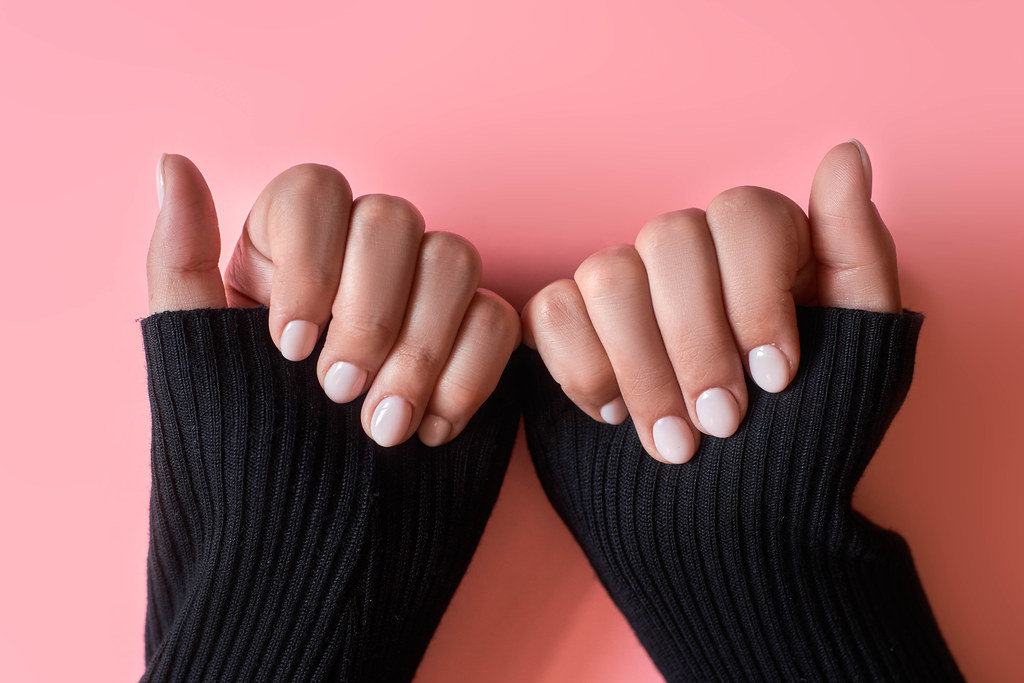 An unrecognizable female showing her hands with beautiful nail manicure