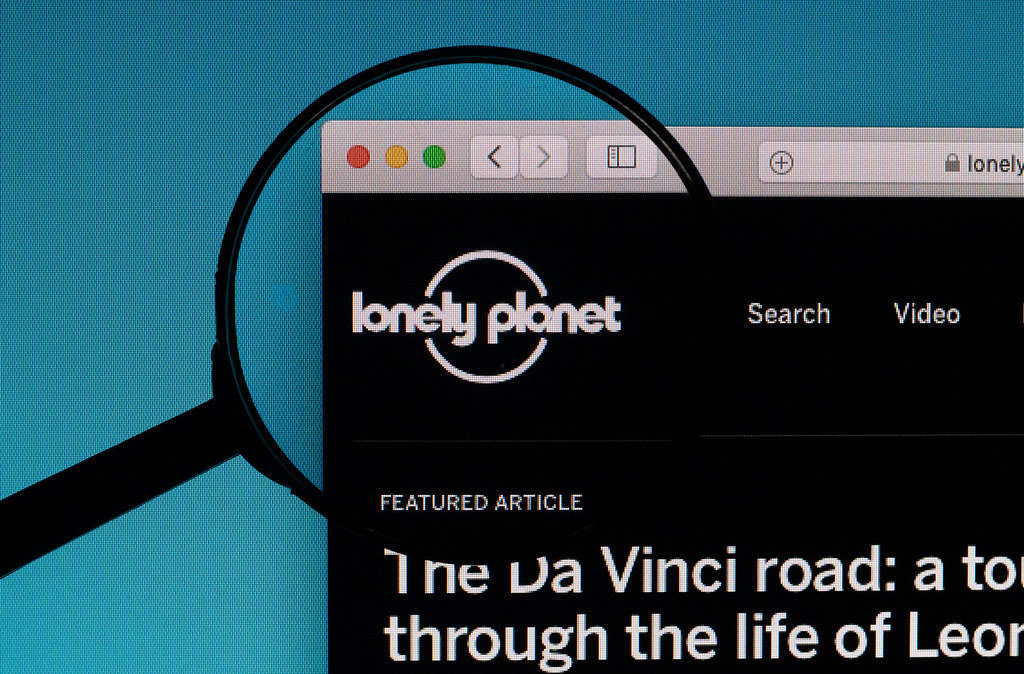 Lonely Planet logo under magnifying glass