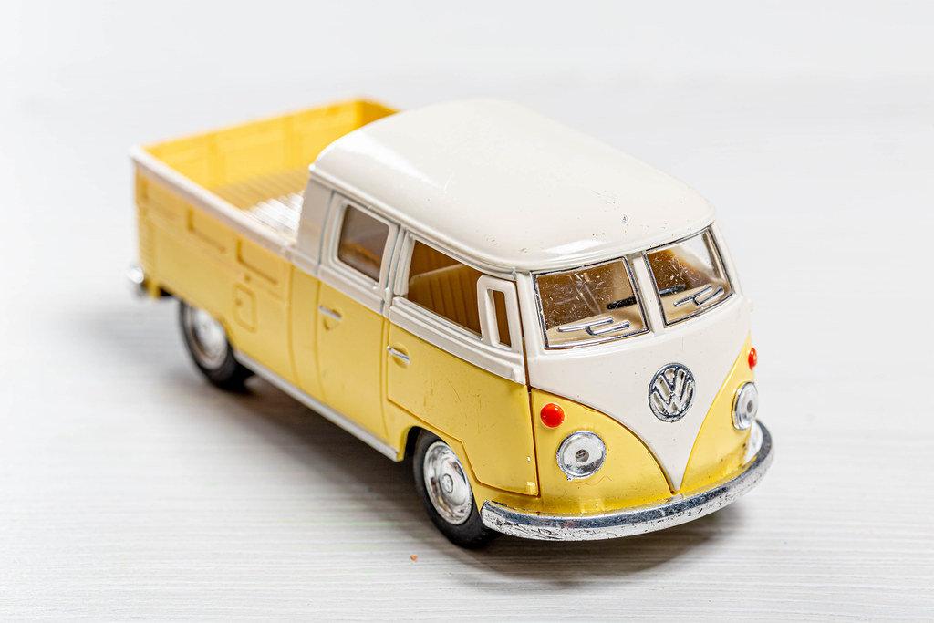 Childrens metal model Volkswagen pickup truck on white background