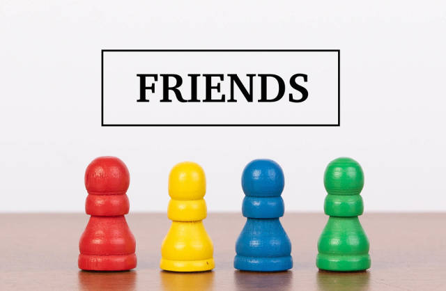 Friends concept with pawn figurines on table