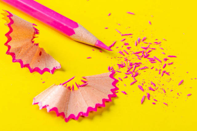 Pink pencil close-up with shavings and sharp tip