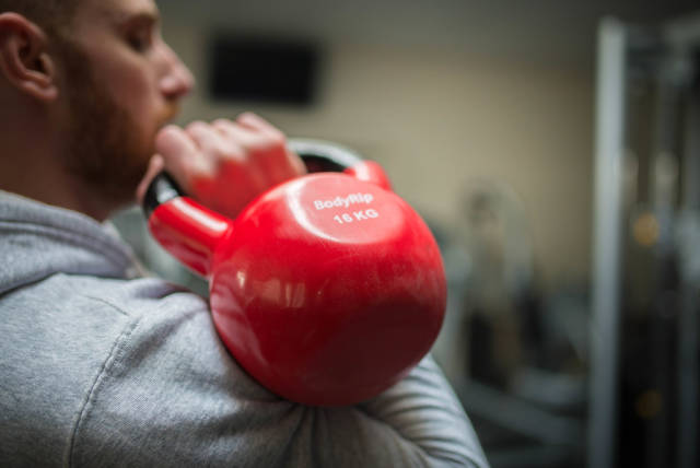 Doing Kettlebell Push Press with one arm