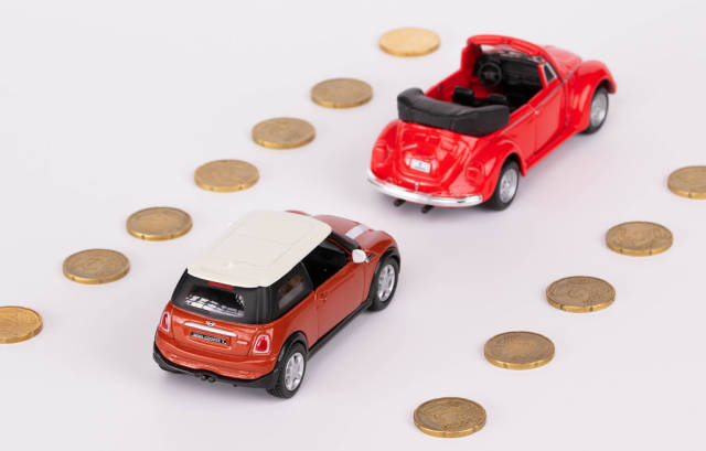 Toy car on the road made from coins