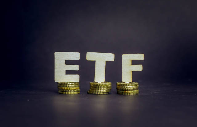 Exchange traded fund - ETF on golden coins