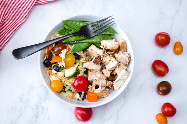 Chicken in a Bowl with Salad and Snow Pea Top View