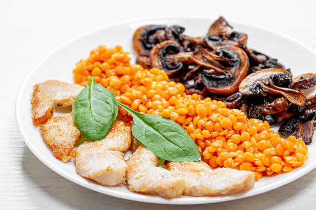 Baked chicken fillet with mushrooms and lentils
