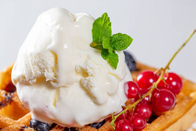 Sweet homemade berry belgian waffle with ice cream