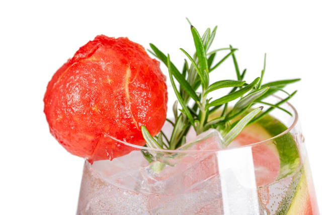 Close-up, watermelon cocktail with ice cubes and rosemary branches