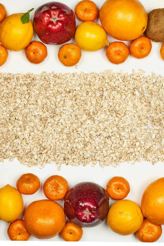Organic and tropical raw fruits with oatmeal
