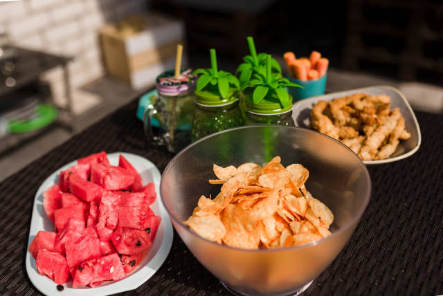 Kid Party Snack Table With Chips And Watermelon