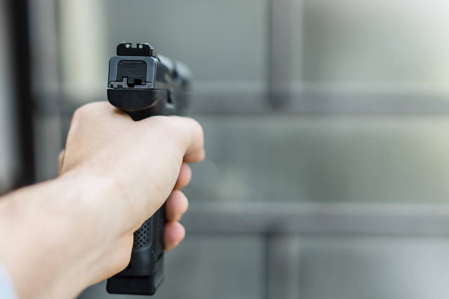 Close Up on Hand Holding the Gun