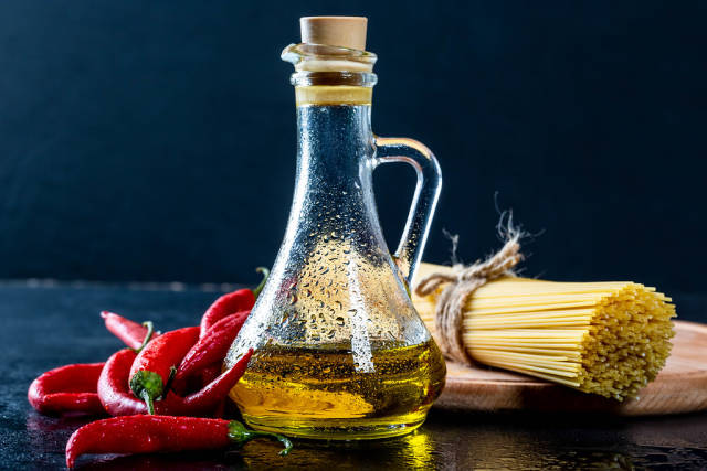 Olive oil with chili and spaghetti