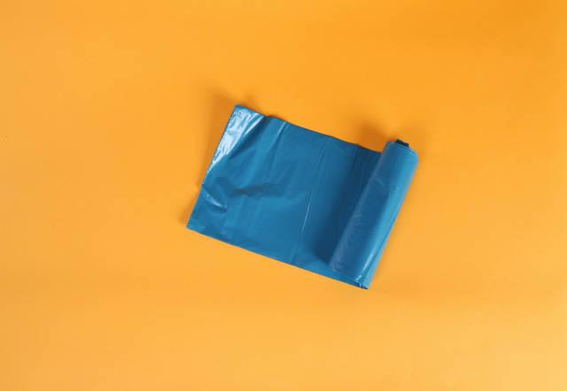 Blue plastic garbage bag roll
