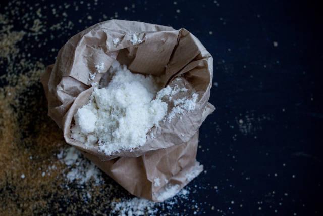 Flour in brown craft paper bag