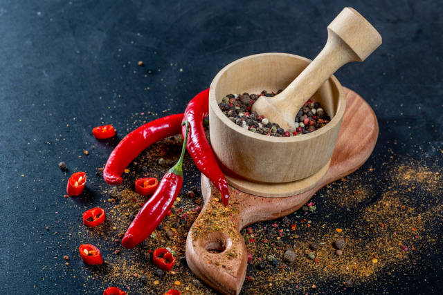 Mix peppers in wooden mortar and chili pepper