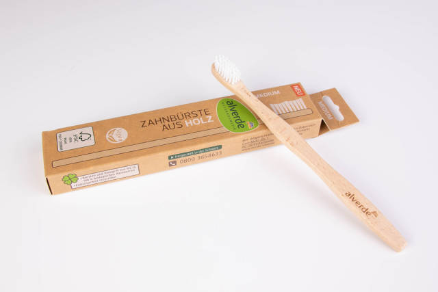 Bamboo toothbrush on white background