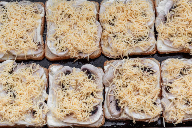 Sandwiches with slices of mushrooms, sauce and cheese