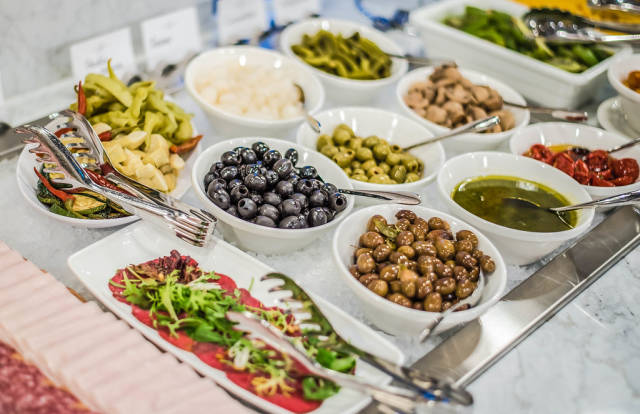 Table Served With Olives And Vegetables