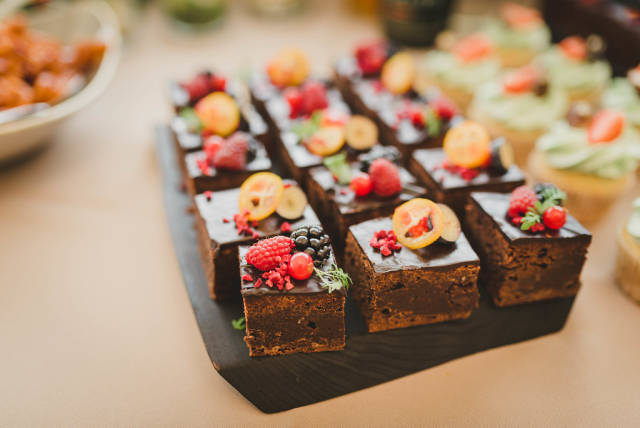 Delicious Sweet Brownie Squares With Various Berries On Top