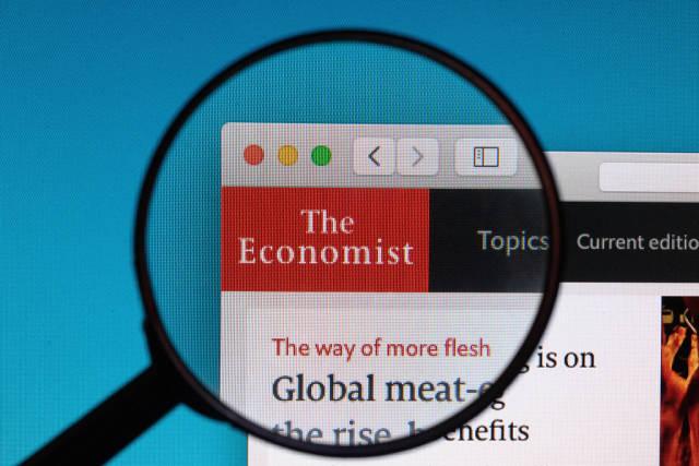 The Economist logo under magnifying glass