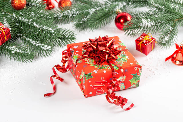 Christmas gift with red bow on new year background