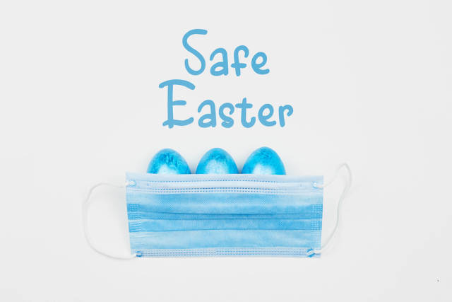 Safe Easter concept with decorated eggs and protective face mask