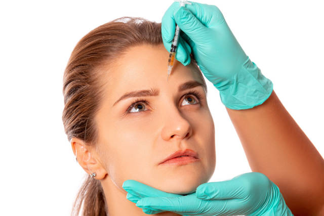 The doctor cosmetologist makes the rejuvenating facial injections