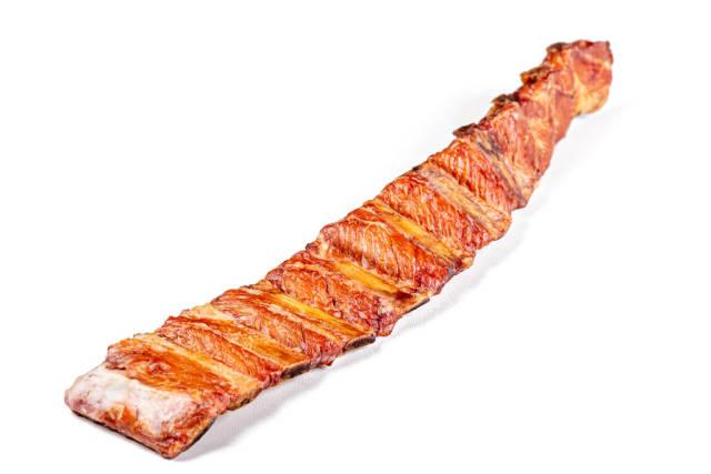 Smoked pork ribs on a white background