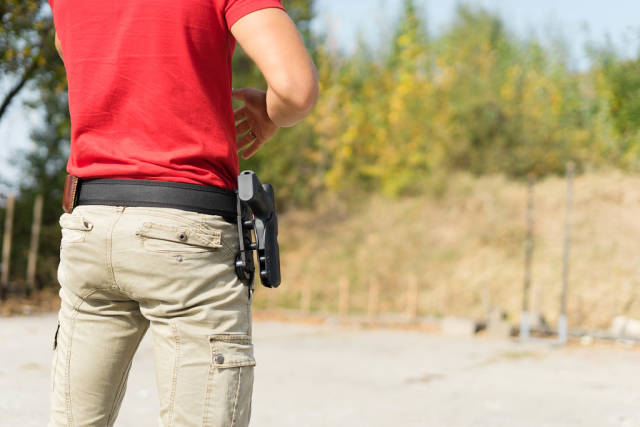 Man in Red T-Shirt At The Shooting Range