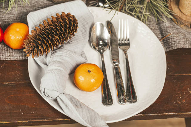 Beautiful table setting with christmas decorations, close up