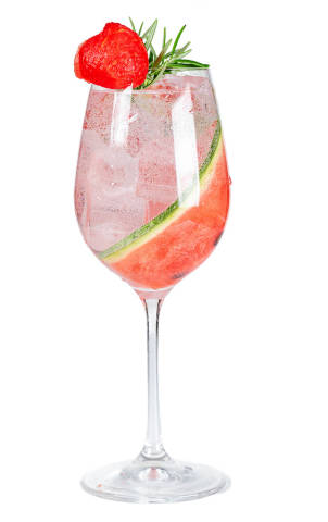 Glass of refreshing watermelon drink with ice and rosemary on a white background