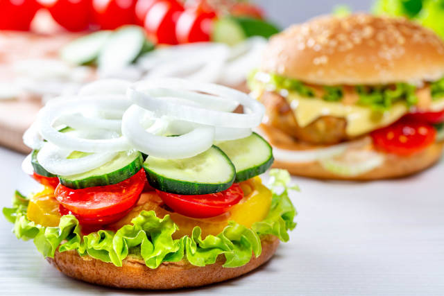 Cooking hamburgers with vegetables at home