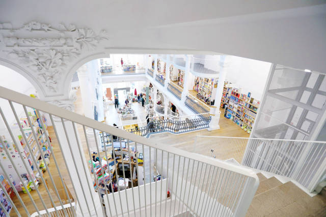 Interior view of modern bookshop with stairs
