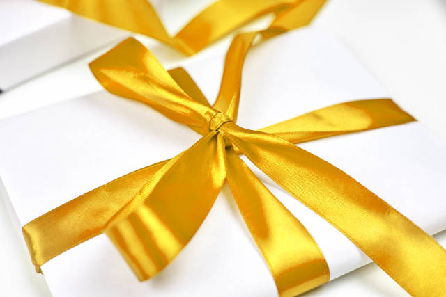 Christmas gift with beautiful yellow textile ribbon