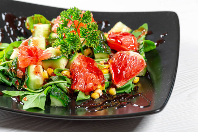 Close-up of fruit and vegetable salad with pomegranate sauce