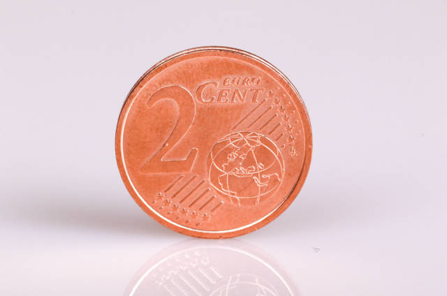 Two Euro cent coin on white background