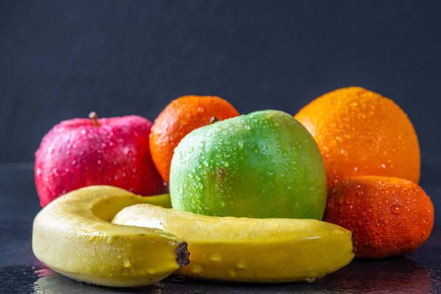 Fresh ripe fruit on dark background