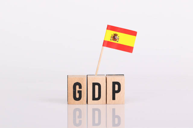 Wooden blocks with the word GDP and flag of Spain
