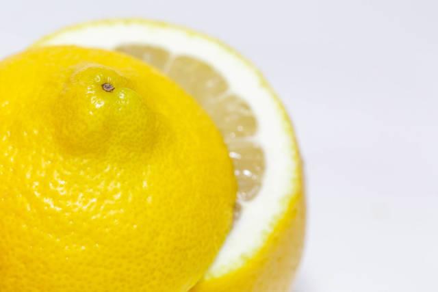 Fresh ripe lemons on white background