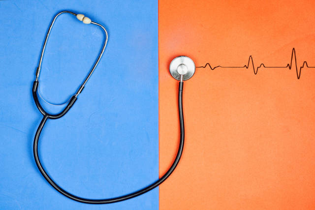 A stethoscope showing listening to a heartbeat