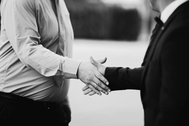Black And White Image Of A Handshake