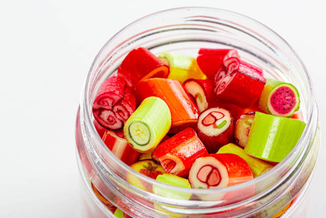 Jar of candy fruit candies close up