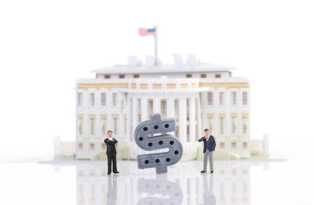 Two businessman standing in front of White House with Dollar sign