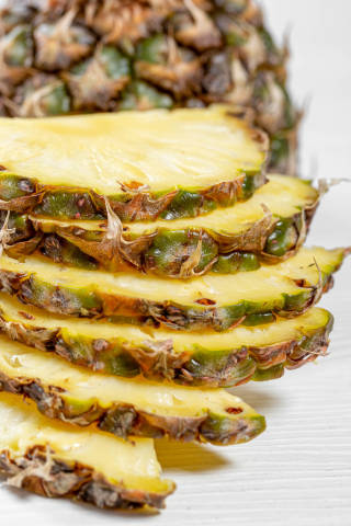 Pineapple, sliced into half rings close up