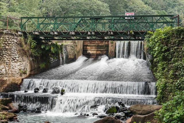 Man-made dam in with bridge in Mambukal Resort